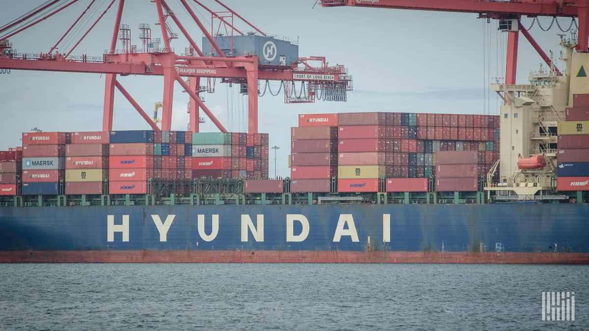 A Chinese container ship's cargo is unloaded.