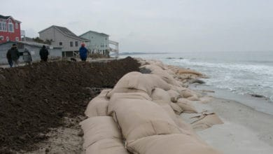 Sand bags piled up along a U.S. beach to prevent flooding.