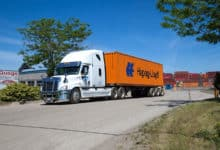 A tractor-trailer from Gusgo Transport, a Canadian carrier being acquired by TFI International