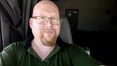 Canadian truck driver Randy James Ulch, pictured in the cab of his truck, believes its important to stand against racism as a white person