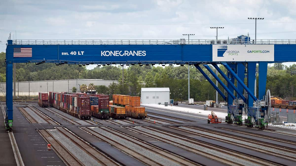 A photograph of containers at a rail yard.