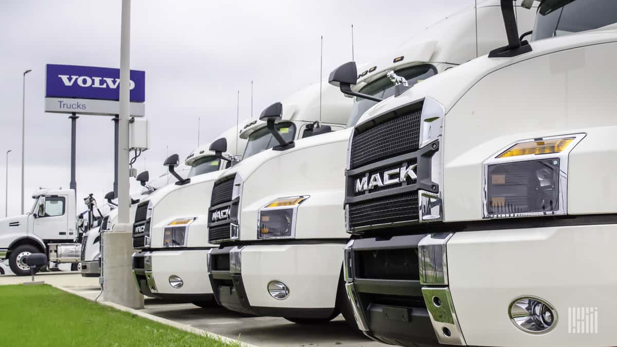 Row of Volvo trucks and signage
