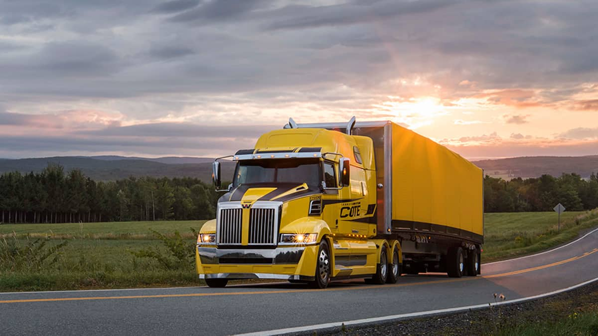 Yellow Western Star truck on aroad