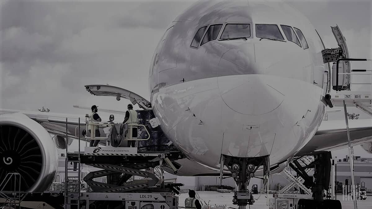 Black and white cargo plane in loading process