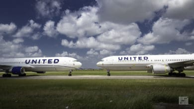 Two white United jets pointed nose-to-nose at each other. United Airlines is being cautious about adding aircraft to its schedule while the economy is still depressed.