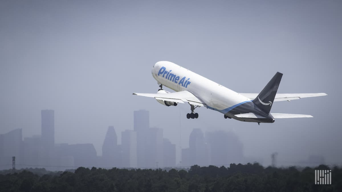 An Amazon Air plane takes off, view from behind as it gets airborne.