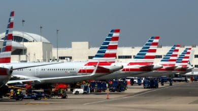 American Airlines planes with striped tails lined up at gates at Los Angeles airport. American Airlines is entering a codeshare partnership with JetBlue.