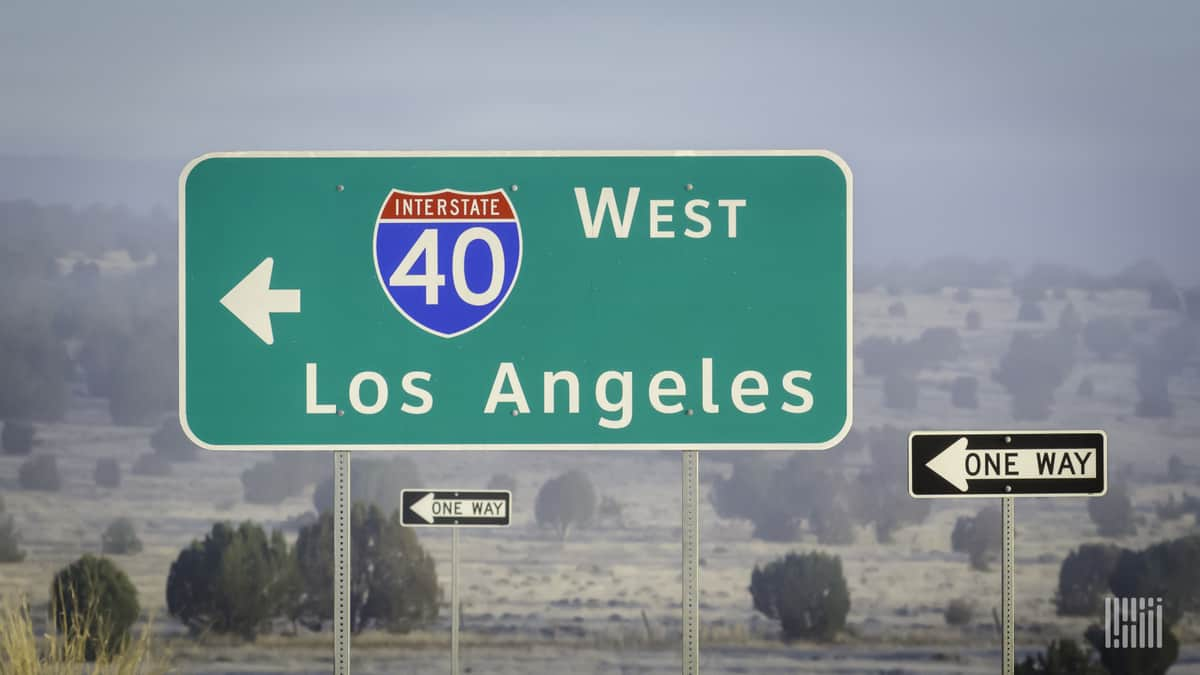 A highway directional sign pointing the way to Los Angeles on I-40. (Photo: Jim Allen/FreightWaves)
