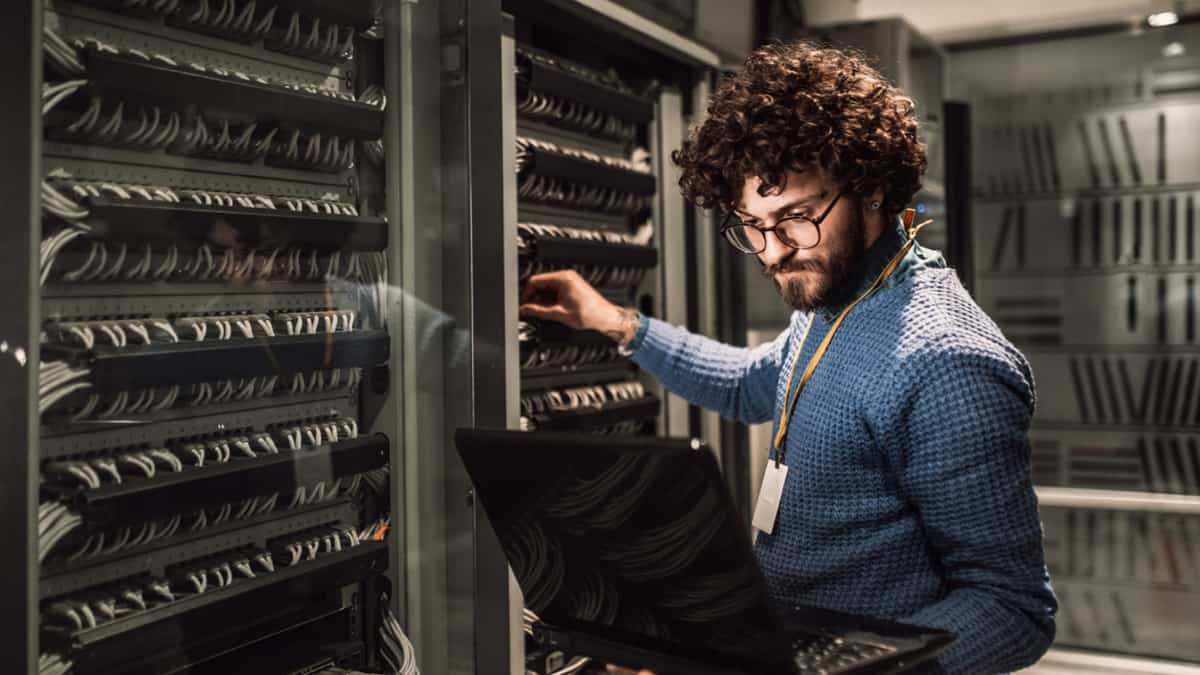 An IBM engineer works at a bank of servers...