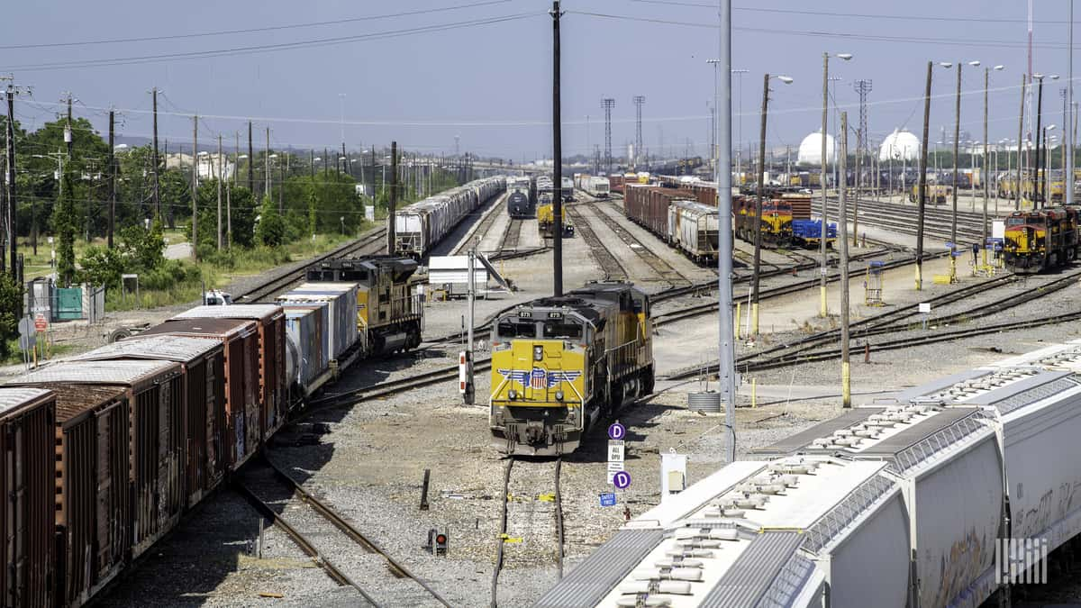 A photograph of a Union Pacific train in a rail yard.