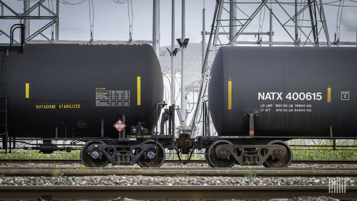 A photograph of two tank cars in a rail yard.
