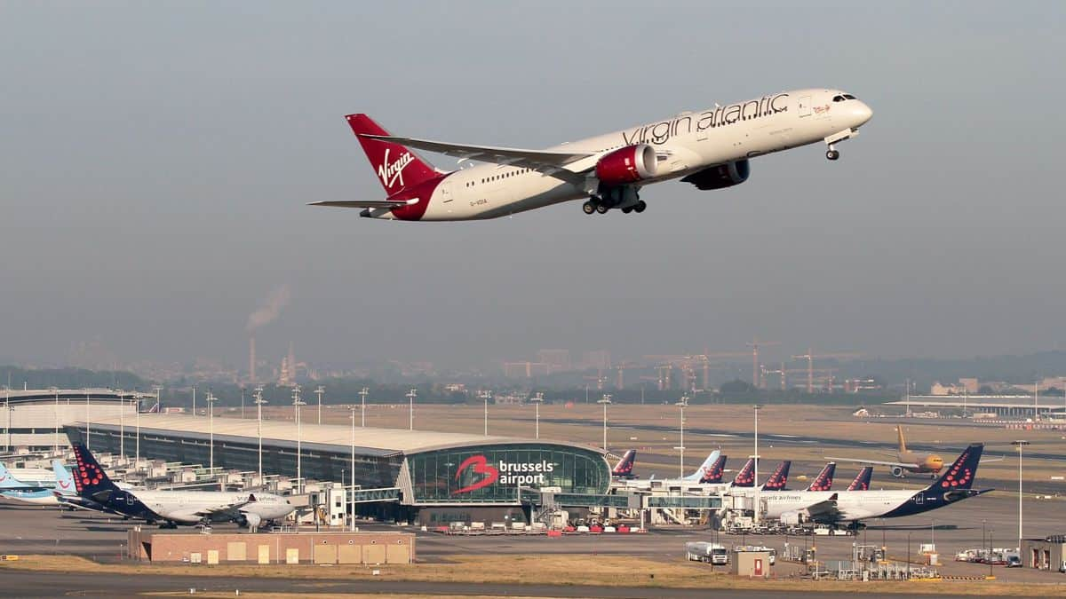 A white and red Virgin Atlantic plane takes off from Brussels Airport. The airport saw positive cargo growth in June for the first time since February.