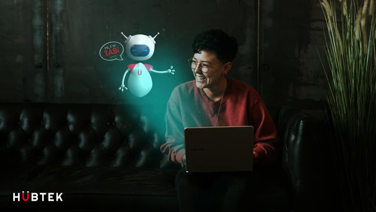 Worker sitting behind laptop with a cartoon bot
