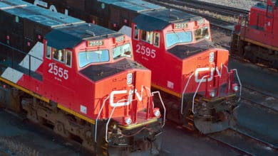 A photograph of two freight train engines.