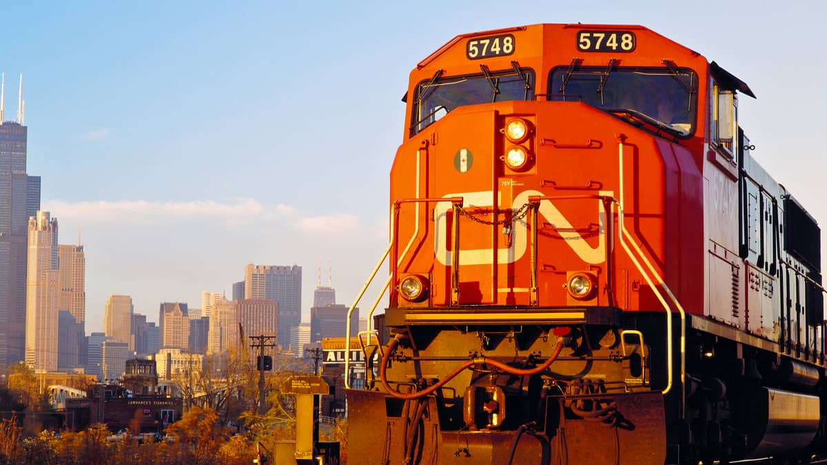 A photograph of a CN train heading away from a city.