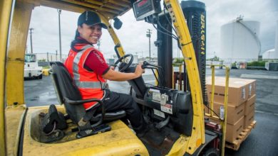 Delta Air Lines cargo worker driving a forklift.