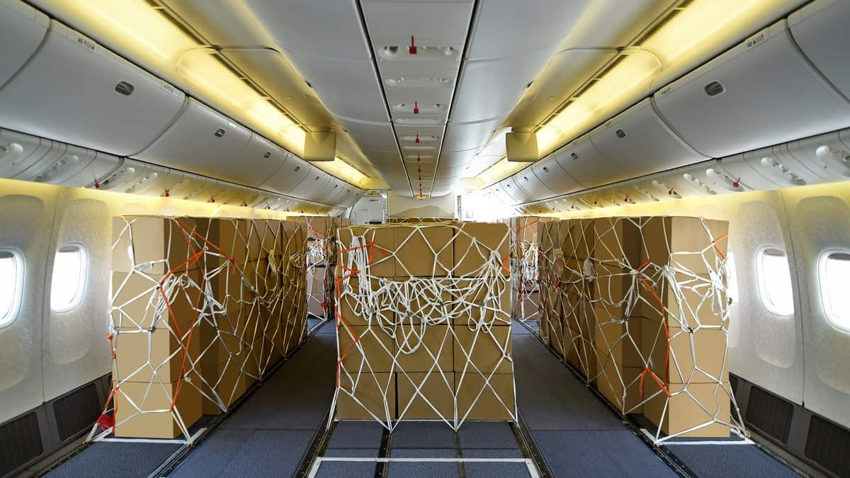 Boxes stored in cabin where passenger seats normally go.