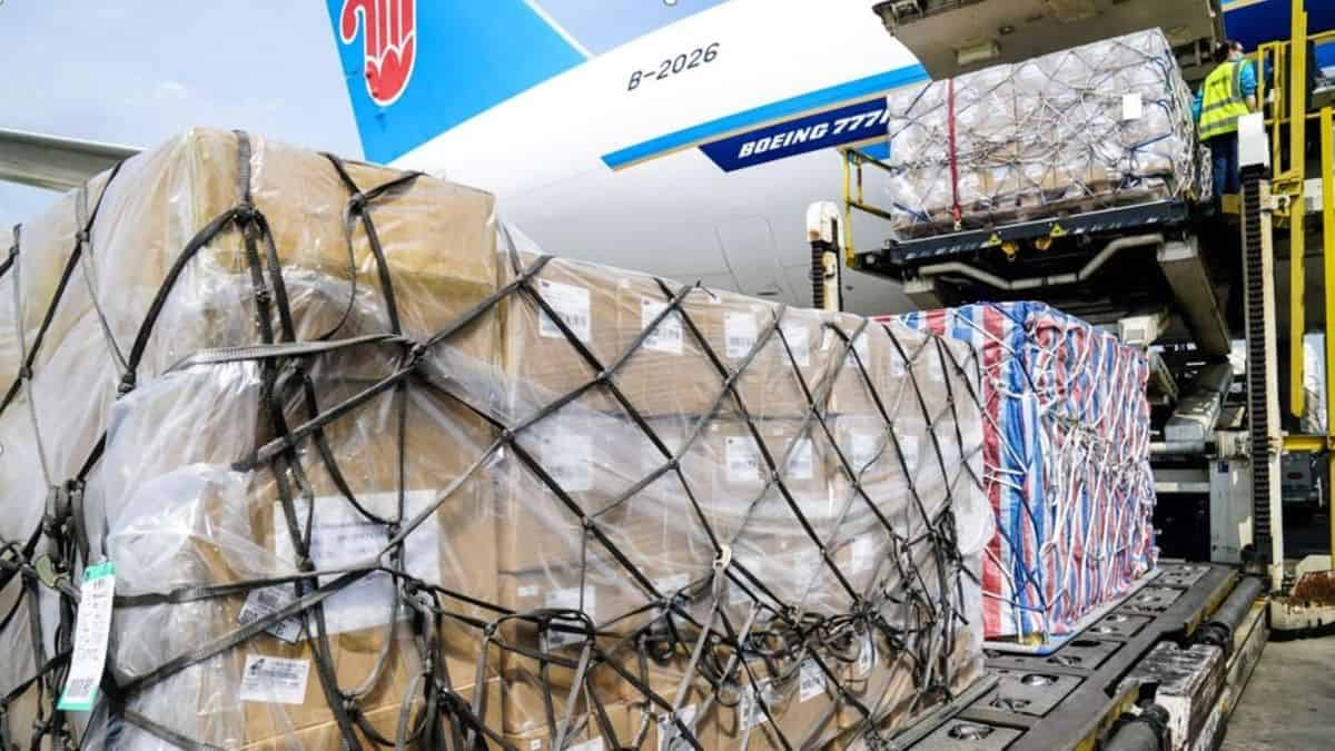 Cargo pallets come off a the rear door of a big cargo plane. China cargo capacity is shrinking and rates are going back up, according to the latest data.