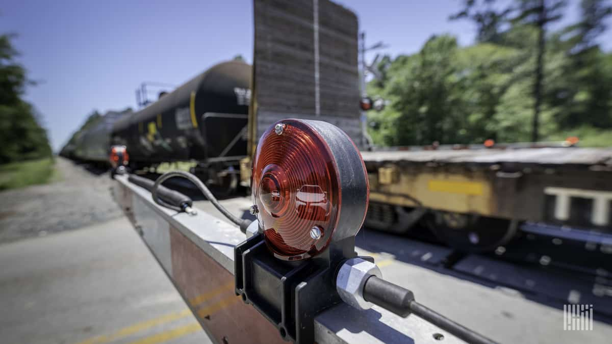 A close-up photograph of a rail crossing.