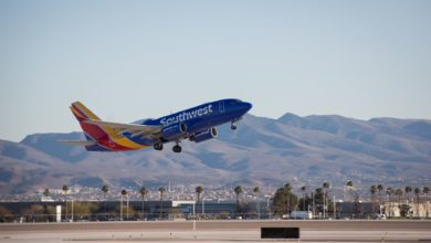 A Southwest Airlines jet pained in blue takes off at desert airport. Southwest posted a $1.5 billion second-quarter loss.