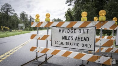 Road closed sign in flooded area.