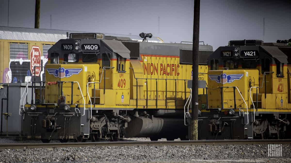 A photograph of a Union Pacific train at a rail yard.