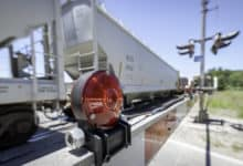 Covered hoppers passing through rail crossing
