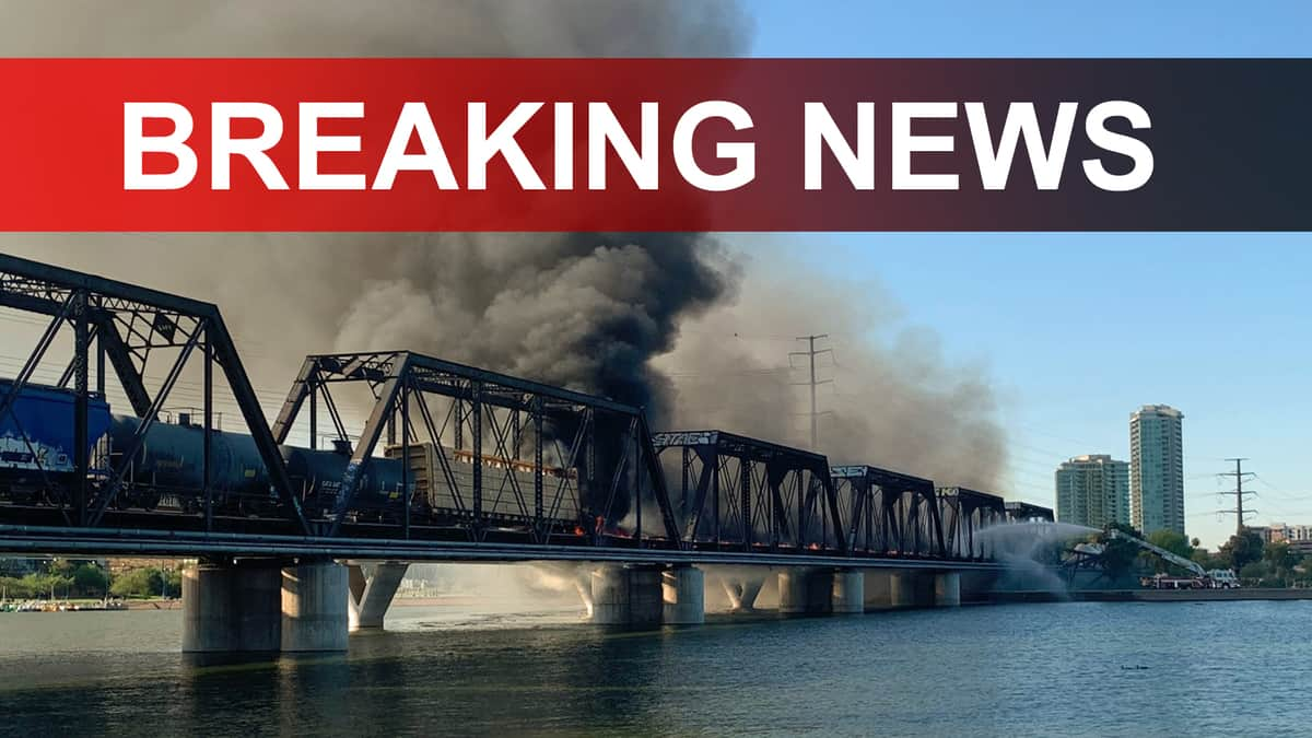 A photograph of a bridge with a large plume of smoke coming from it. The words Breaking News are written on top of the photograph.