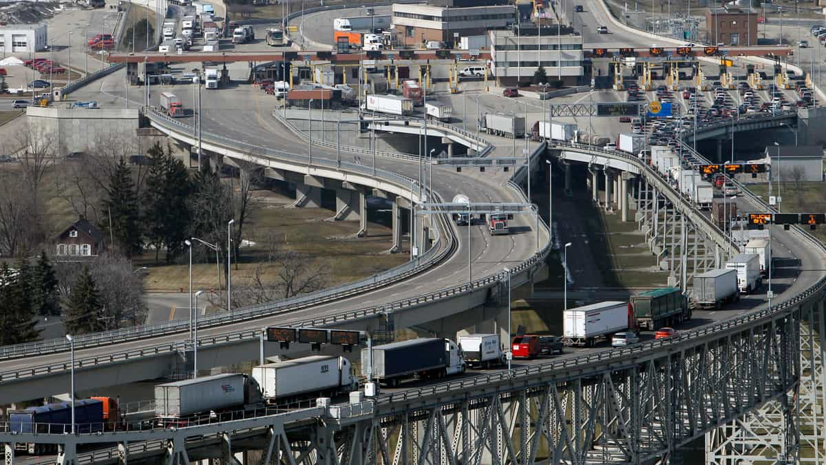 A view of trucks crossing the U.S.-Canada border. The border's closure for non-essential travel has been extended to Aug. 21