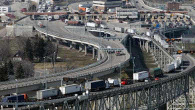 Truck cross the Blue Water Bridge at the US-Canada border. The USMCA trade agreement may impact cross-border trade.