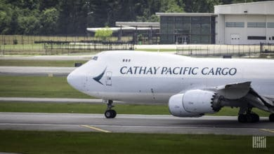 A white Cathay Pacific jumbo jet gets ready to takeoff. Cathay Pacific is bolstering its cargo team with new additions.