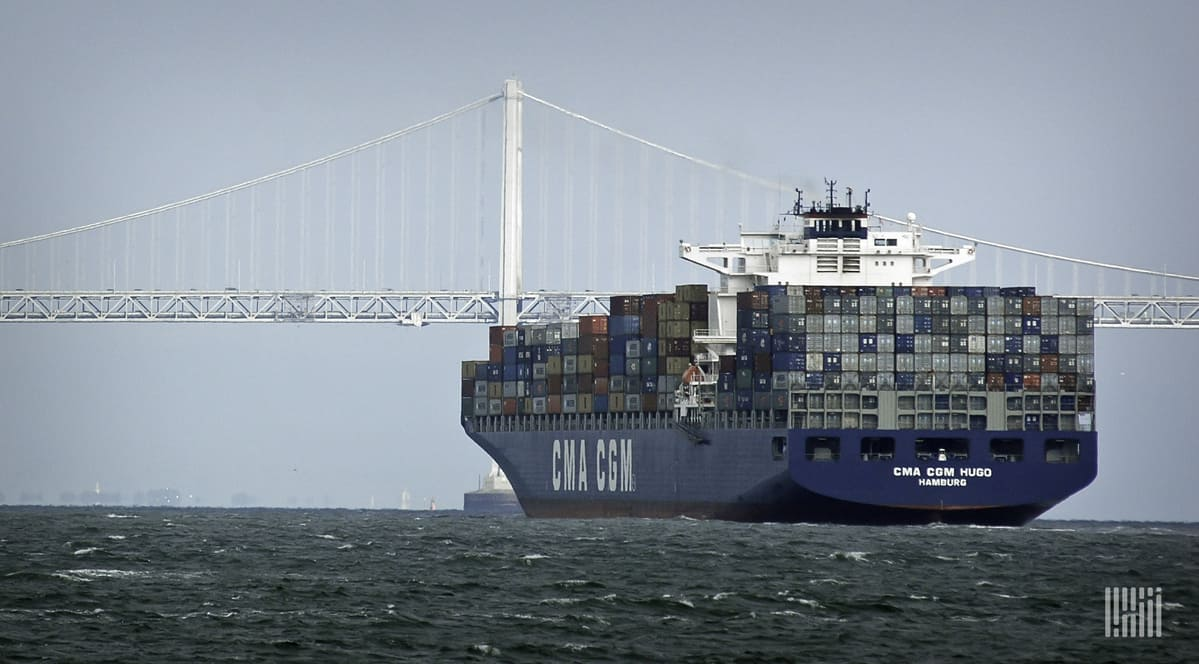 A cargo ship heads toward port with a full load of containers.