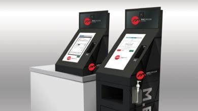 Two black and red kiosks in white room