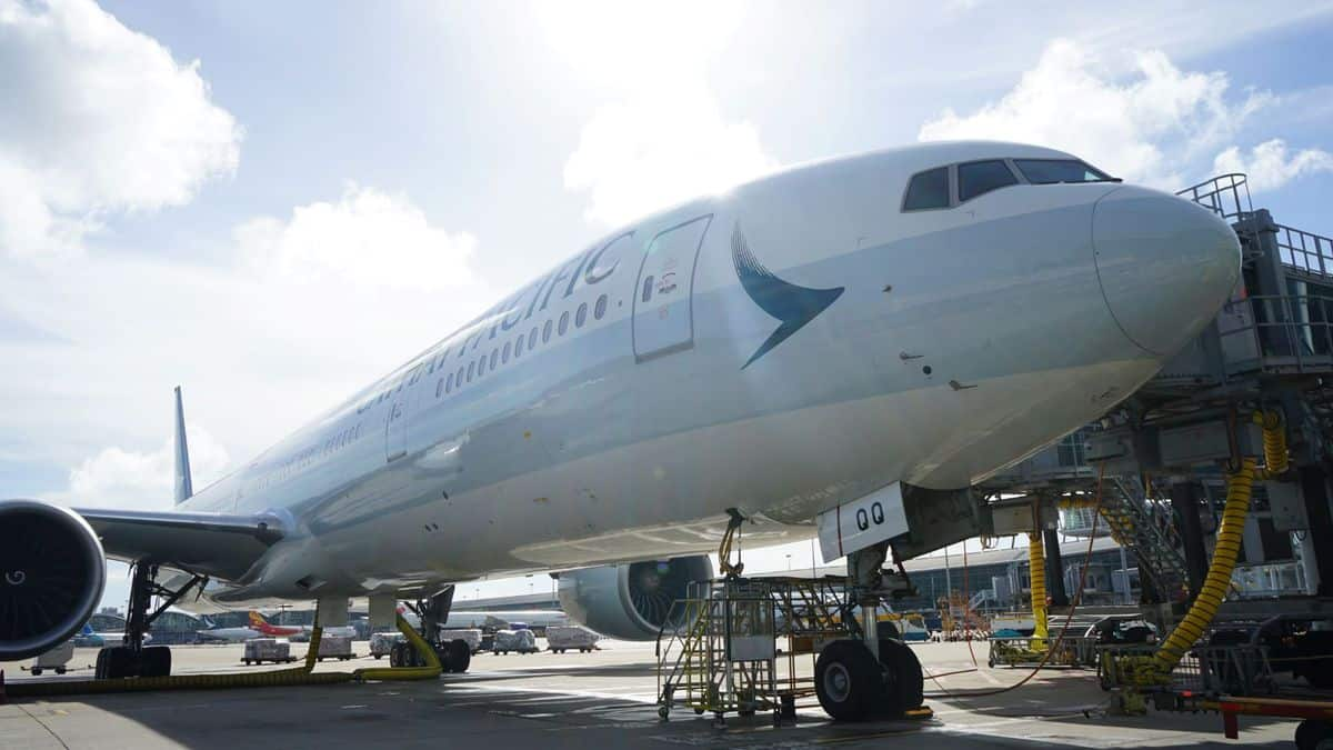 A Cathay Pacific widebody jet, up close side view. Cathay Pacific is removing seats from a couple planes to increase cargo capacity.