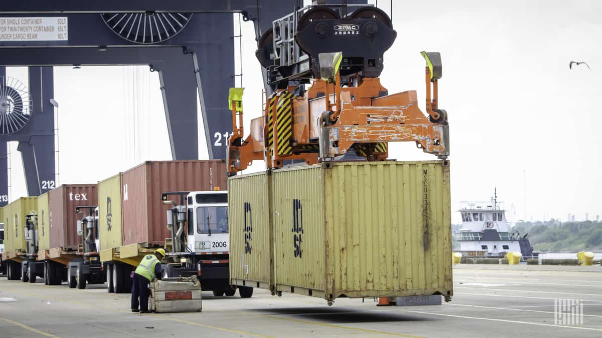 A container held by a crane at a U.S. port.