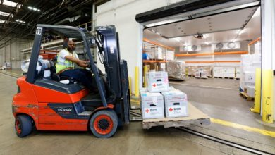 A forklift operator moves packages of blood at Lufthansa's cold storage facility in Chicago.