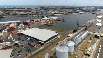 Aerial view of the Port of Melbourne, which could suffer work slowdowns because of new COVID safety measures.