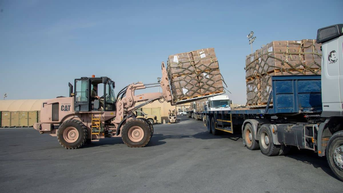 U.S. military fork lift puts pallets on a truck as part of airlift of relief supplies to Beirut, which is suffering the effects of a huge explosion at the port.