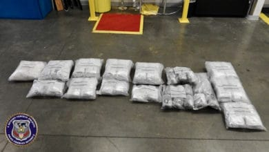 Bags of meth seized by authorities at the US-Canada border. A trucker has been charged with meth trafficking in connection with the seizure.