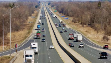 Trucks drive on Highway 401, where police say they found a truck driver smoking opium