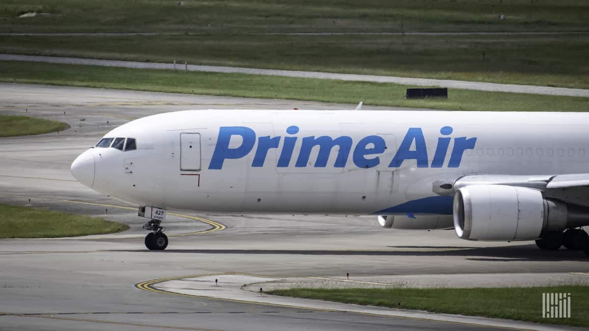 "Front-half of a white Amazon jet with the words ""Amazon Prime"" on the side. Amazon is giving more flying business to ATSG, an air cargo carrier."