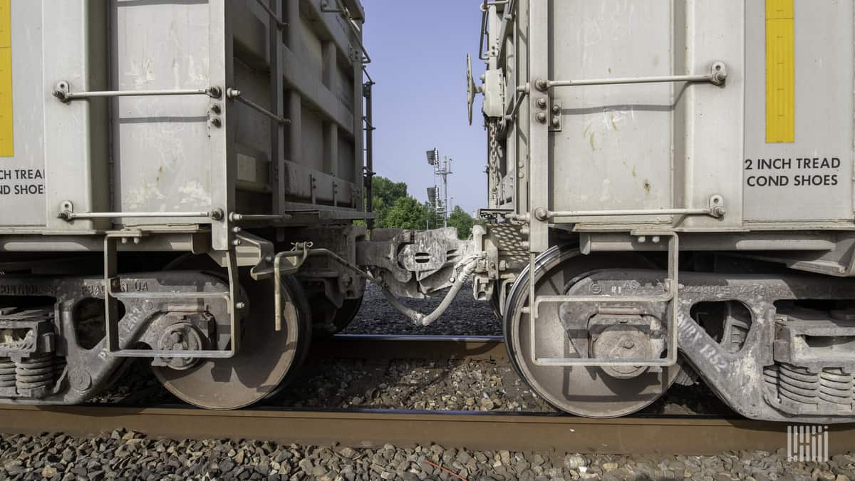 A photograph of two railcars connected to each other.