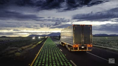 Truck driving on highway at dusk