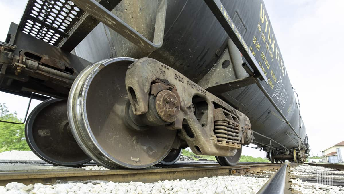 A photograph of a railcar wheel on a track.