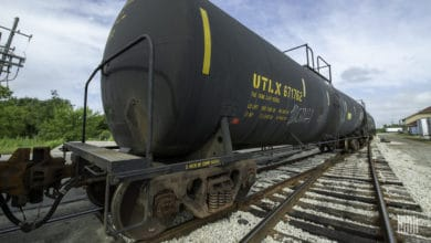 A photograph of a tank car in a rail yard.