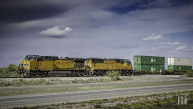 A photograph of a Union Pacific train pulling double stacked intermodal containers.