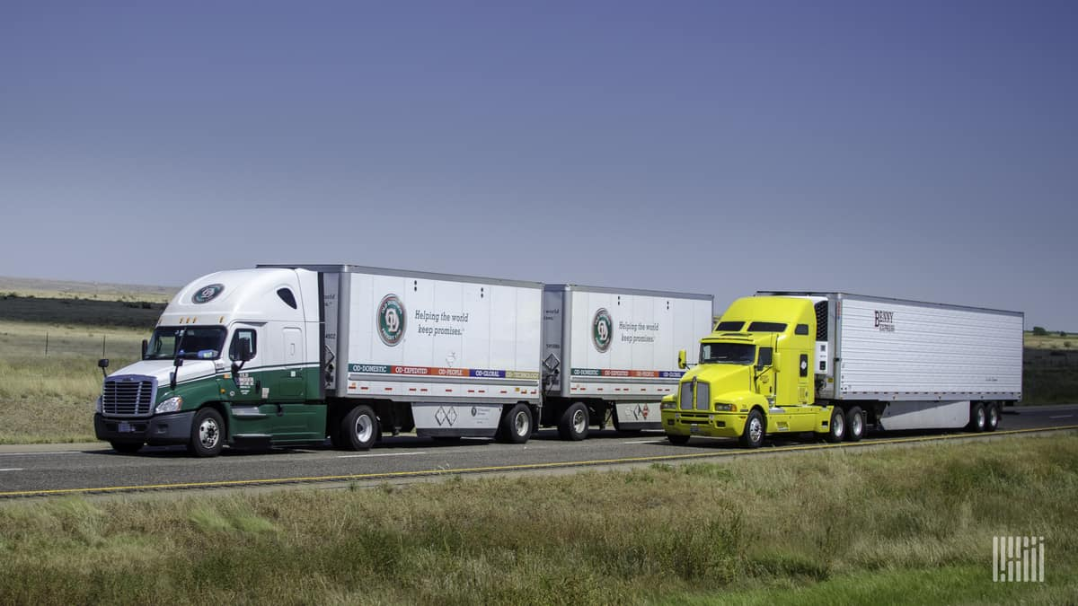Old Dominion double next to truckload rig on highway
