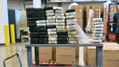 Packages of suspected cocaine seized by Canada Border Services Agency officers from a truck crossing from the United States. The truck driver was arrested.