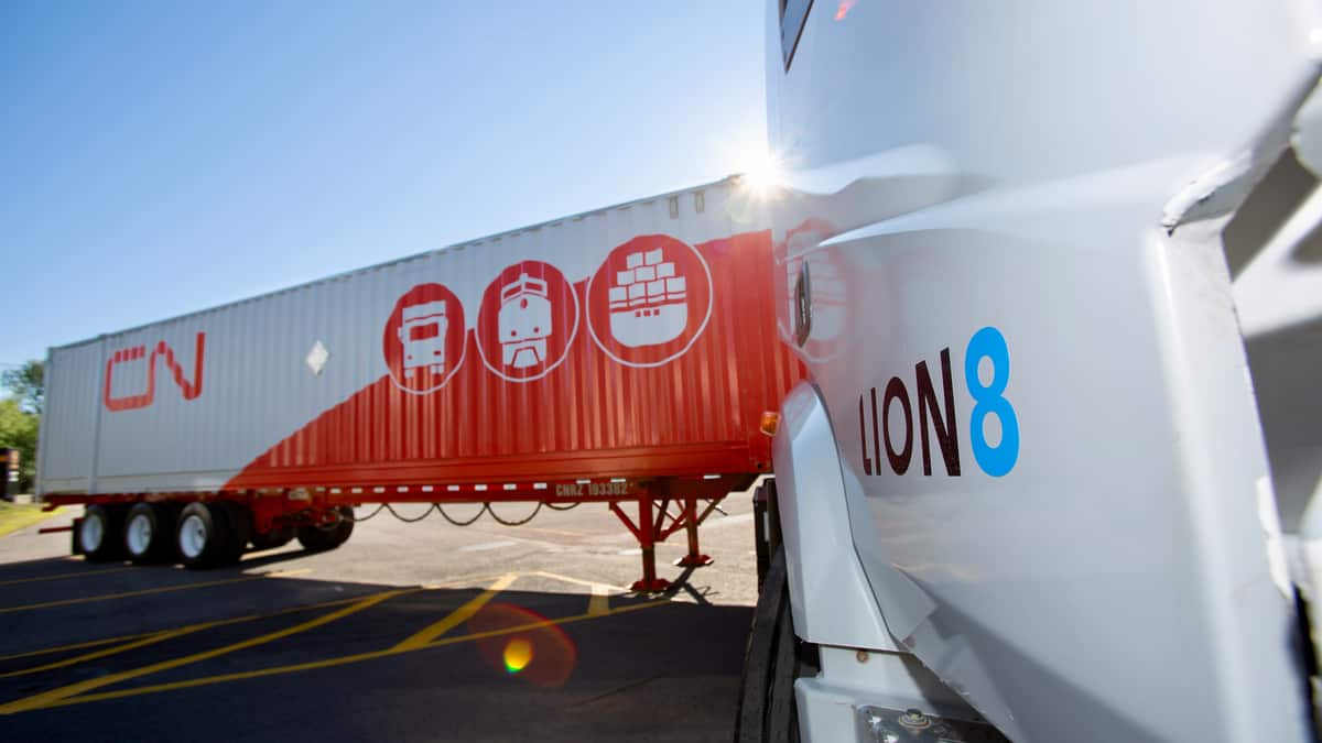 A Lion8 truck attached to a CN intermodal container.