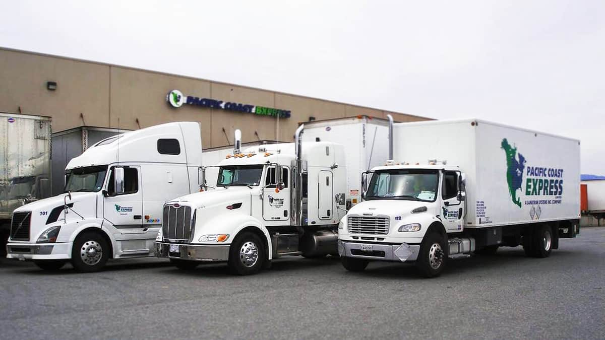 Three parked trucks from Pacific Coast Express, a Canadian less-than-truckload carrier recently acquired by Mullen Group.